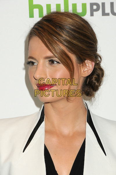 "Stana Katic.PaleyFest 2012 Presents ""Castle"" held at The Saban Theatre, Beverly Hills, California, USA, 9th March 2012..portrait headshot lipstick hair up  jacket white  black red bun .CAP/ADM/BP.©Byron Purvis/AdMedia/Capital Pictures."