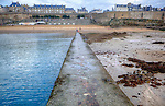 Saint-Malo (Breton: Sant-Malo&ugrave;; Gallo: Saent-Mal&ocirc;) is a walled port city in Brittany in northwestern France on the English Channel. It is a sub-prefecture of the Ille-et-Vilaine department.<br /> The population can increase to up to 200,000 in the summer tourist season. With the suburbs included, the population is about 135,000.<br /> Inhabitants of Saint-Malo are called Malouins, Malouines.