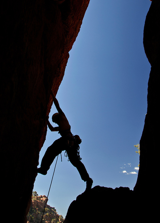 """Pat Winstanley begins leading the 5.11""""Devils Advocate"""" route in Upper Devils Canyon near Superior, Arizona."""