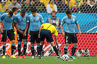 Referee uses the vanishing spray at the feet of Uruguay players