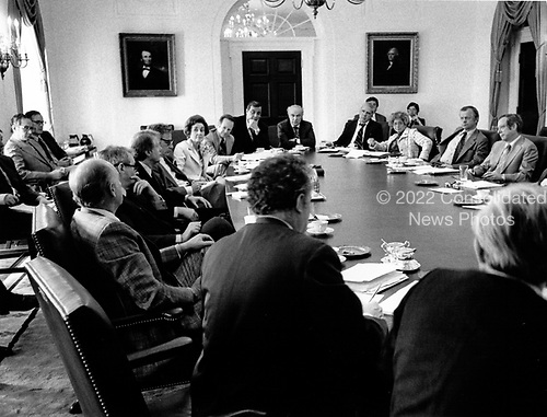 United States President Jimmy Carter and his cabinet discuss the energy program at a cabinet meeting in the Cabinet Room of the White House in Washington, DC on April 18, 1977.  The President is scheduled to deliver energy address to the nation on live television in the evening.  In his remarks, the President will equate the energy crisis as the &quot;moral equivalent of war.&quot;<br /> Credit: White House via CNP