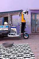 A rickshaw is parked in the courtyard of the Adarsh Vidya Mandir school