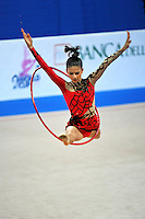 Giulia Pala  (junior) of Italy performs leap thru with hoop at 2010 Pesaro World Cup on August 27, 2010 at Pesaro, Italy.  Photo by Tom Theobald.