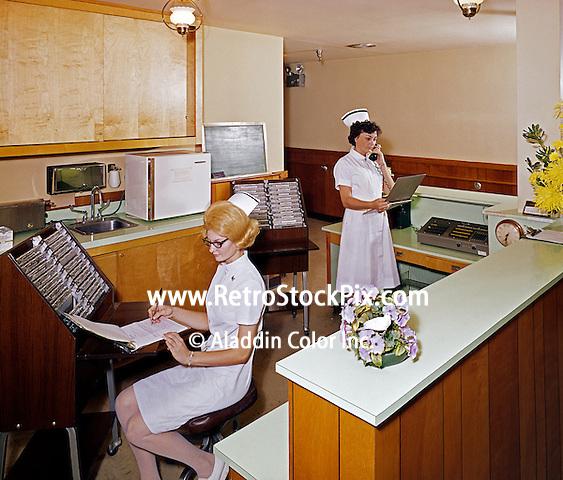Nurses working at the nursing station.