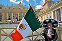 A dressed-up woman with a Mexican flag