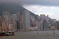 Hong Kong: Downtown skyline, Victoria Peak--shrouded at left. Photo '82.