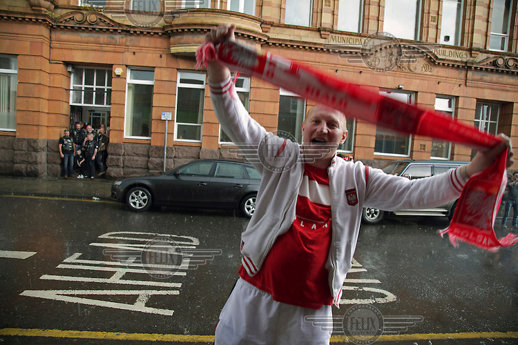 A Polish football fan stands in the rain outside a pub broadcasting the Polish national team playing in the Euro 2016 tournament. <br /> The town of Boston had the country's highest proportion of 'leave' votes cast in the EU referendum with almost 76 percent of ballots cast for Brexit. Lincolnshire has, in recent years, seen an influx of EU workers drawn to the area's agricultural industry. The 2011 census found about 13 percent of Boston's residents were born in Eastern Europe and migrated to the UK since 2004.