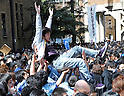 March 10, 2011, Tokyo, Japan - A test-taker is tossed in the air in body-lifting, a form of celebration, as Tokyo University announces the results of the second phase of its entrance examinations on the Hongo campus in Tokyo on Thursday, March 10, 2011. A total of 3009 applicants passed the exams to be enrolled by the nationÅfs most prestigious institution. (Photo by Natsuki Sakai/AFLO) [3615] -mis-