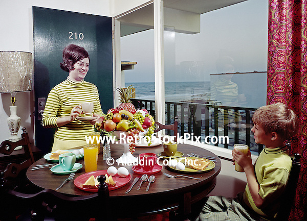 Atlantic Breeze in Myrtle Beach, SC. Mother having breakfast with her son in a motel room. 1970