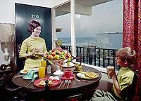 Atlantic Breeze in Myrtle Beach, SC. Mother having breakfast with her son in a motel room. 1970
