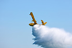 Water Bomber CL-415 firefighting amphibious aircraft releasing water at Canadian International Air Show in Toronto