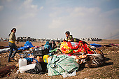 ARBAT, IRAQ: A family move their belongings in a refugee camp on the outskirts of Arbat in the semi autonomous region of Iraqi Kurdistan. ..Refugees from Syria, most of whom are Kurds, have been arriving at camps in Kurdistan trying to escape the continuing conflict.  Arbat is located approximately 20 kilometres away from Sulaimaniyah...Photo by Ali Arkady/Metrography.