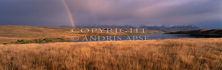 Rainbow above Lake Alexandrina. Mackenzie Country. Canterbury Region. New Zealand.