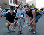 The Devitt family (L to R: Mike, Ewan, and Angela) during the Main Street Mile run in downtown Boise, Idaho on June 22, 2012.