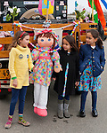 March 31, 2013 - Garden City, New York, U.S. - Three young girls stand next to life-size doll attached to rear of 1929 Model A Ford PickUp decorated for Easter, at the 58th Annual Easter Sunday Vintage Car Parade and Show sponsored by the Garden City Chamber of Commerce. Hundreds of authentic old motorcars, 1898-1988, including antiques, classic, and special interest participated in the parade.