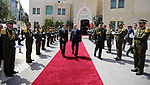 Palestinian Prime Minister Rami Hamdallah and Austria's Chancellor Christian Kern review the honor guard during a welcome ceremony in the West Bank city of Ramallah, on April 23, 2017. Photo by Prime Minister Office