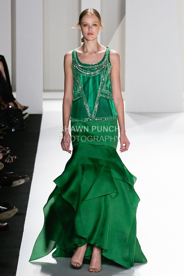 Frida Gustavsson walks the runway in a grass green silk geometric jacquard top with beading detail, grass green silk gazar skirt with multiple fold detail for the Carolina Herrera Spring 2012 fashion show, during Mercedes-Benz Fashion Week Spring 2012.