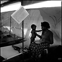 Luanda, Angola, May 19, 2006.Saraifa, 1, with his mother Rosalia, 20, is a patient at the Boa Vista MSF Belgium operated cholera field clinic. Between February and June 2006, more than 30000 people were infected with cholera in Angola's worse outbreak ever; more than 1300 died.