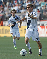 LA Galaxy midfielder Michael Stephens (26) controls the ball and looks to pass. In a Major League Soccer (MLS) match, the New England Revolution (blue) defeated LA Galaxy (white), 5-0, at Gillette Stadium on June 2, 2013.