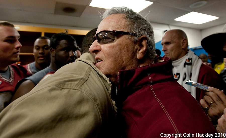 JACKSONVILLE, FL 1/1/10-FSU-WV FB CH104-Florida State Head Coach Bobby Bowden hugs a former player in the locker room after his final game in the Gator Bowl, Friday in Jacksonville, Fla. The Seminoles beat West Virginia 33-21..COLIN HACKLEY PHOTO