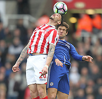 Stoke City's Geoff Cameron jumps with  Chelsea's Marcos Alonso<br /> <br /> Photographer Mick Walker/CameraSport<br /> <br /> The Premier League - Stoke City v Chelsea - Saturday 18th March 2017 - bet365 Stadium - Stoke<br /> <br /> World Copyright &copy; 2017 CameraSport. All rights reserved. 43 Linden Ave. Countesthorpe. Leicester. England. LE8 5PG - Tel: +44 (0) 116 277 4147 - admin@camerasport.com - www.camerasport.com