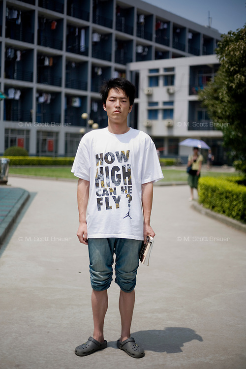 Zhilonghu, a student, age 21, poses for a portrait in Nanjing. Response to 'What does China mean to you?': 'The People's Republic of China'  Response to 'What is China's role in the future?': 'To act as a peacekeeper among the world's model nations.'