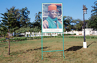 Gambia. Banjul. Banjul is the capital of Gambia. Poster of the president of the republic of Gambia, Mr. Alhaj Yahya Jameeh, near the arch 22. The arch is a memory symbol of the 22 july 1984  succesful coup by captain Alhaj Yahya Jameeh to seize power. © 2000 Didier Ruef