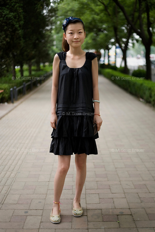 Jinting, a student, age 24, poses for a portrait in Beijing. Response to 'What does China mean to you?': 'A big country, a strong country, a resilient culture.'  Response to 'What is your role in China's future?': 'The path of the women's generation.'