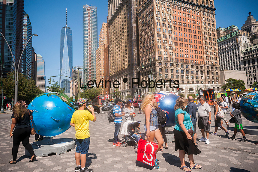 Crowds of tourists in Battery Park in Lower Manhattan in New York on Sunday, September 4, 2016 . (© Richard B. Levine)