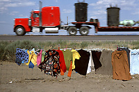 Muriel Kubishin, center, sells a vast array of clothing alongside U.S. Highway 666 at Sheep Springs, N.M. on the Navajo reservation. Citizen groups petitioned the federal government to change the number of the road for fear the devilish connection contributed to accident and fatality rates on the highway.