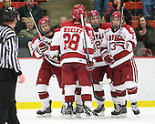 Rence Coassin (Harvard - 17), Chris Huxley (Harvard - 28), (Valek), Danny Biega (Harvard - 9) and Michael Del Mauro (Harvard - 13) celebrate Del Mauro's goal. - The Harvard University Crimson defeated the St. Lawrence University Saints 4-3 on senior night Saturday, February 26, 2011, at Bright Hockey Center in Cambridge, Massachusetts.