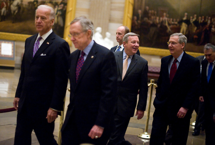 From left, Vice President Joe Biden, Senate Majority Leader Harry Reid, D-Nev., Senate Majority Whip Richard Durbin, D-Ill., and Senate Minority Leader Mitch McConnell, R-Ky., make their way through the rotunda to hear President Barack Obama deliver his State of the Union address in the House Chamber, Jan. 27, 2010.