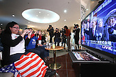 Jan. 21, 2009; Obama, Fukui Prefecture, Japan - Americans Lucia Brea and Ashley Hayes take pictures of President Barack Obama on a tv screen during a live telecast of the Inauguration Ceremony at an Obama inauguration viewing party at Hotel Sekumiya.
