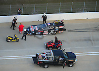 Jan. 21, 2012; Jupiter, FL, USA: Aerial view as safety crews  surround the car of of NHRA funny car driver John Force after blowing an engine during testing at the PRO Winter Warmup at Palm Beach International Raceway. Mandatory Credit: Mark J. Rebilas-