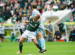 Hibs v St Johnstone...25.08.12   SPL.Leigh Griffiths fends of Frazer Wright.Picture by Graeme Hart..Copyright Perthshire Picture Agency.Tel: 01738 623350  Mobile: 07990 594431