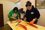Sisters Terrie Brigham and Kim Brigham Campbell cleaning freshly caught Sockeye Salmon at their store, the Brigham Fish Market in Cascade Locks, Oregon
