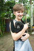 Nursing a very affectionate 8-month old baby Gibbon.