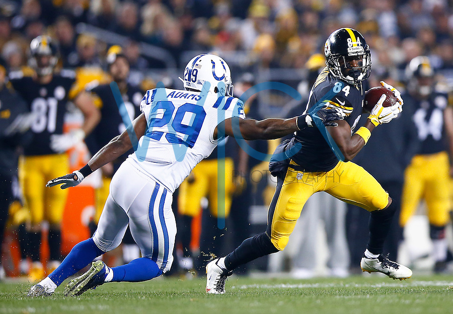 Antonio Brown #84 of the Pittsburgh Steelers runs through a tackle by Mike Adams #29 of the Indianapolis Colts after catching a pass in the first half during the game at Heinz Field on December 6, 2015 in Pittsburgh, Pennsylvania. (Photo by Jared Wickerham/DKPittsburghSports)