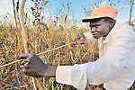 Kwaje Natan hunts with a bow and arrow for small game near the small village of Pisak, in Southern Sudan's Central Equatoria State. Natan is a United Methodist.