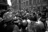 Roma 1994  .I minatori delle miniere del Sulcis in Sardegna manifestano  davanti a Palazzo Chigi sede del Governo per protestare contra la chiusura delle miniere. .Il Presidente del Consiglio Silvio Berlusconi incontra i minatori in Piazza Colonna..Rome 1994.The miners of the mining in Sardinia Sulcis show at Palazzo Chigi in front of government headquarters to protest against the closure of the mines..The President Silvio Berlusconi meets the miners in Piazza Colonna.