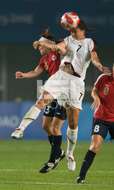 USWNT midfielder (7) Shannon Boxx heads the ball over Norwegian midfielder (13) Lene Storlokken during first round play for the 2008 Beijing Olympics in Qinhuangdao, China. .  The US lost to Norway, 2-0, at Qinhuangdao Stadium.