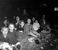 These women and children were liberated when the concentration camp for the Jewish prisoners at Lambach, Austria, was overrun by the 71st Inf. Div.  Death rate at the camp, mostly from starvation, was reputed to be 200 to 300 a day.  May 7, 1945.  Sgt. Robert Holliway.  (Army)<br /> NARA FILE #:  111-SC-266491<br /> WAR &amp; CONFLICT BOOK #:  1110