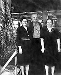 employers portrait with Christmas tree decoration USA 1946