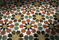 Granada, a stone waterjet mosaic in Emperador Dark, Verde Luna, Rosa Verona, Calacatta Tia and Giallo Reale polished. Paul Schatz for New Ravenna Mosaics.