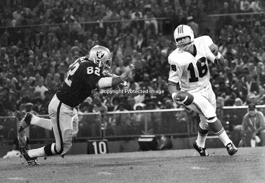 Raiders Horace Jones chasing New England Patriots quarterback Jim Plunkett. (1972 photo/Ron Riesterer)