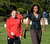 Rachel Buehler walks with Michelle Obama to the next drill station during a Lets Move! soccer clinic held on the South Lawn of the White House.  Let's Move! was started by Mrs. Obama as a way to promote a healthier lifestyle in children across the country.