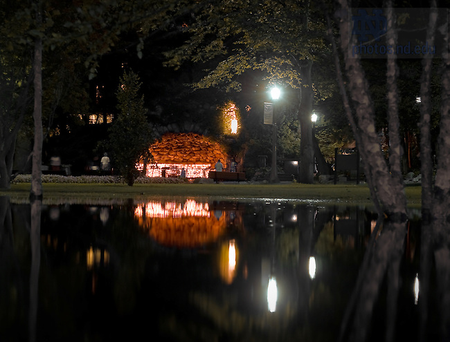 Grotto reflected in water after a rainstorm...Photo by Matt Cashore/University of Notre Dame