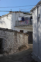 Streets and houses, Capileira, gorge of the Poqueira river, Alpujarra, Andalucia, Southern Spain. Moorish influence is seen in the distinctive cubic architecture of the Sierra Nevada's Alpujarra region, reminiscent of Berber architecture in Morocco's Atlas Mountains. Photograph by Manuel Cohen.