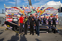 Sept. 1, 2014; Clermont, IN, USA;  Toyota staff pose with NHRA funny car driver Alexis DeJoria and her father John Paul DeJoria as they celebrate after winning the US Nationals at Lucas Oil Raceway. Mandatory Credit: Mark J. Rebilas-USA TODAY Sports