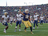 Ben Koyack (18) celebrates after scoring a touchdown in front of Navy Midshipmen cornerback Brandon Clements (1) and cornerback Parrish Gaines (2) in the third quarter.